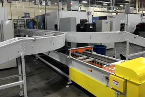 Machine tending conveyor system