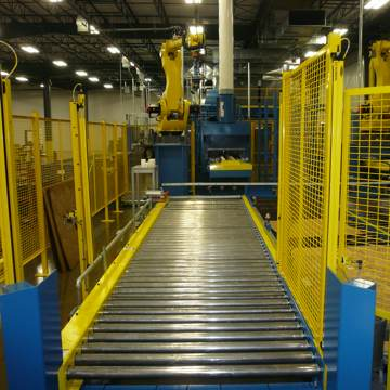 Integrated conveyor and robotic system