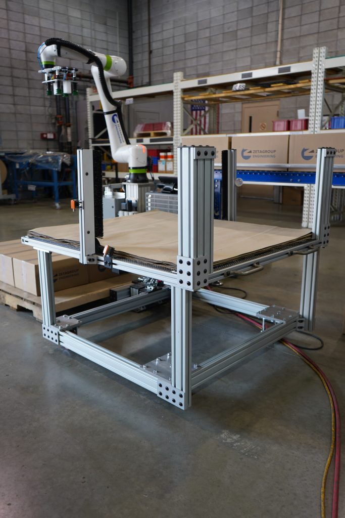 Slip/tier sheet stand for palletizing boxes