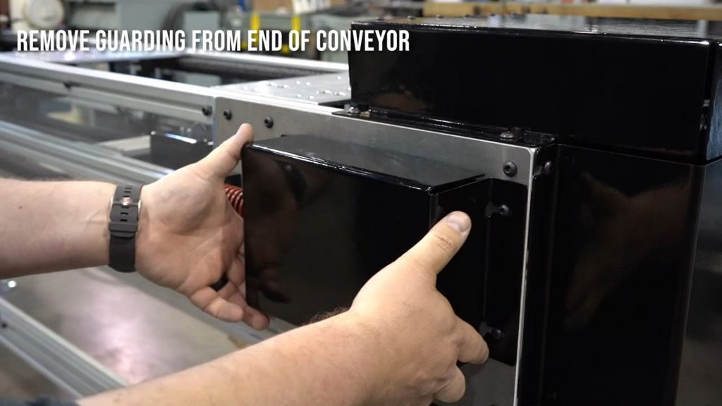 Removing the guarding from the end of an over under conveyor